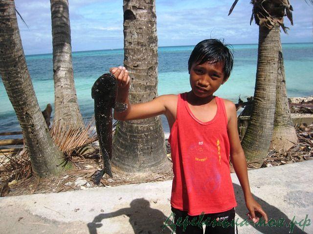 филиппинский мальчик рыбак